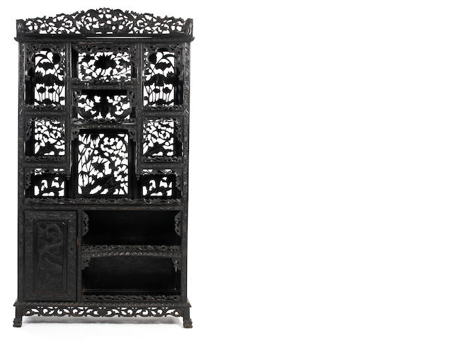 A Chinese carved and pierced hardwood display cabinet, late 19th/early 20th Century