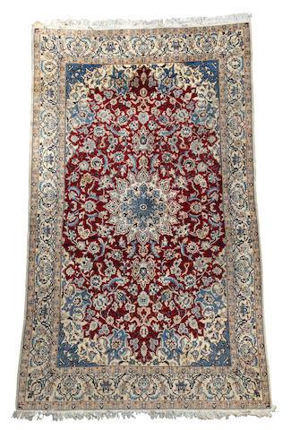 A Nain carpet 340cm x 188cm