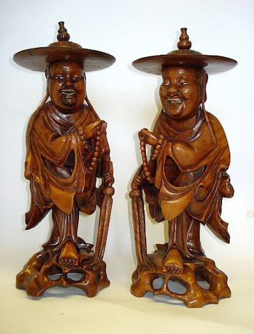 A pair of Japanese rootwood figures of immortals late 19th Century