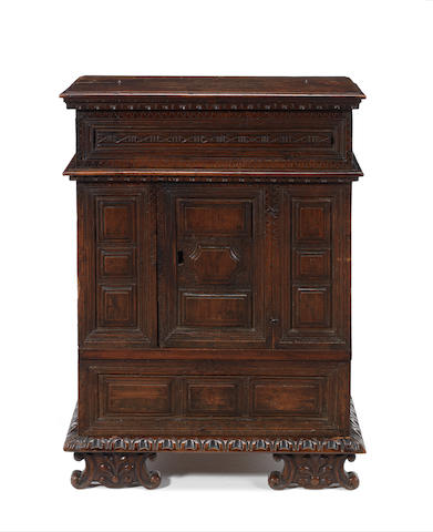 An Italian late 17th century carved walnut cabinet