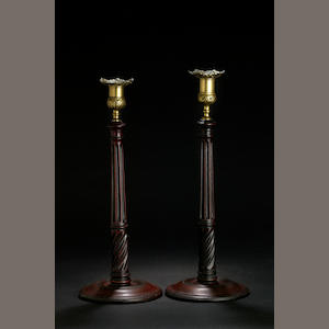 A pair of George III mahogany candlesticks