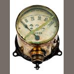 A brass & bevelled edged glass 50mph speedometer by Jos W. Jones