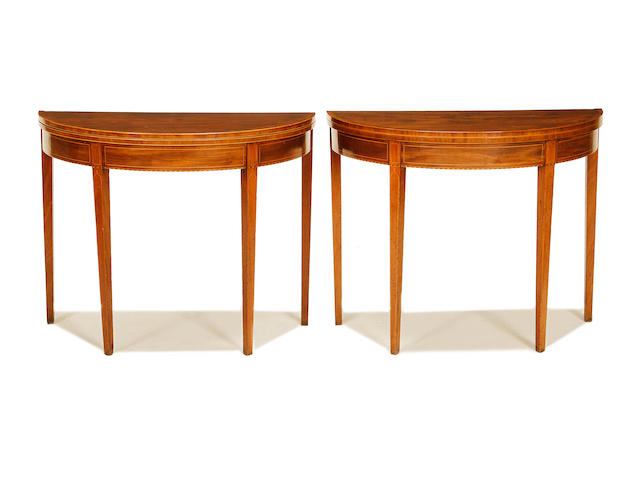 A pair of late George III mahogany demi-lune card tables