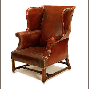 A George III and later mahogany wingback armchair