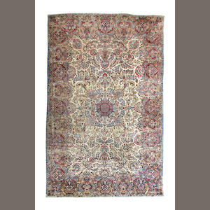 A Kirman carpet  Iran 438cm x 310cm.