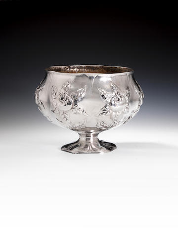 An Edwardian silver hand wrought Arts & Crafts bowl by Gilbert Marks