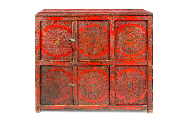 A 19th century Tibetan red polychrome decorated cabinetprobably Central Tibet