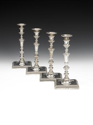 A set of four George III cast silver candlesticks, by John Parker (I) and Edward Wakelin, London 1771,