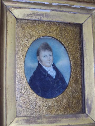 English School, (mid 19th century) Portrait miniature of a gentleman wearing a blue jacket and white stock, on ivory, oval