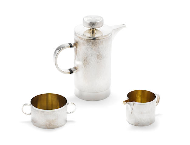 GERALD BENNEY: A possibly unique silver cafatierre,  with a cream jug and two-handled sugar bowl, London 1964,  (3)
