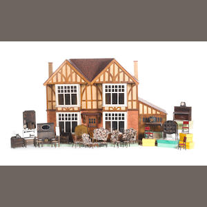 Double fronted mock-Tudor style dolls house and Lines bros furniture, English 1930's