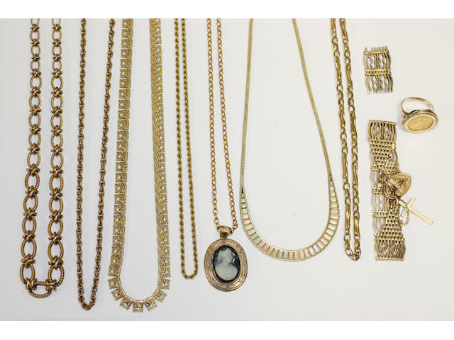 A collection of gold and yellow precious metal jewellery
