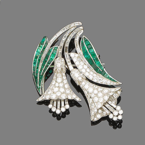 An emerald and diamond double-clip brooch, by Rood,