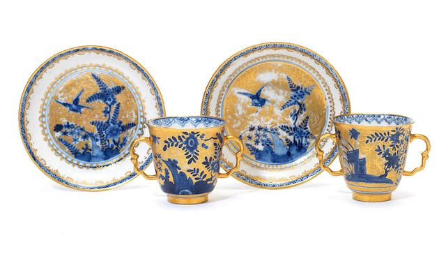 A pair of Meissen Hausmaler two-handled beakers and saucers, circa 1725-35