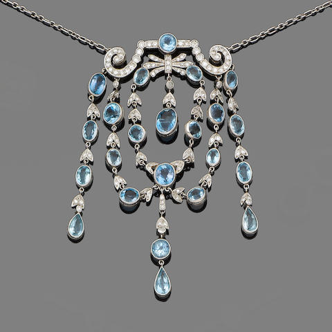 An aquamarine and diamond necklace and a pair of blue topaz and diamond earrings (2) (partially illustrated)