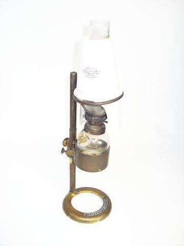A spirit microscope bench lamp, by Swift of London,