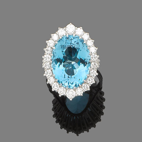 A blue topaz and diamond cluster ring