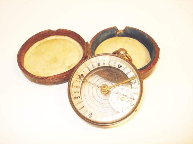 A combined pocket compass and map distance reader, English,  circa 1900,