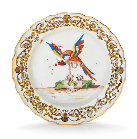 A Meissen plate decorated with the 'Parrot and Spaniel' pattern, circa 1740