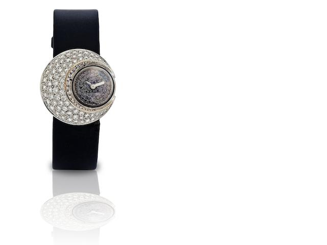 Chanel. An 18ct white gold and diamond set lady's quartz wristwatchRef:7157, Circa 2000