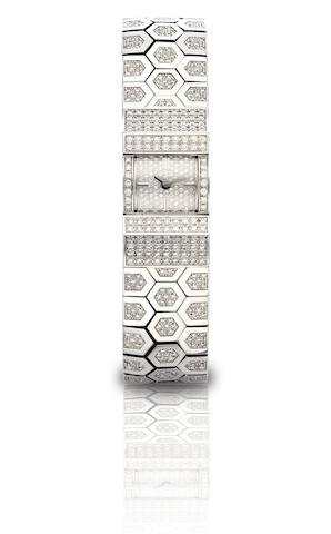 Van Cleef & Arpels. A fine and rare 18ct white gold and diamond set lady's quartz bracelet watchLudo Swann, Ref:338984, Case No.144025, Circa 2003