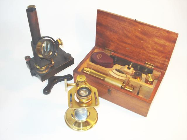 A Baker dissecting microscope, a Baker field microscope and a bench lamp, English, late 19th century, (3)