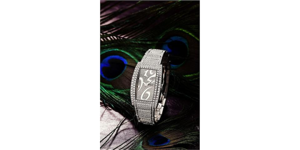 Piaget. A fine and rare 18ct white gold and diamond set lady's quartz bracelet watch Limelight Tonneau, Case No.953048, Recent