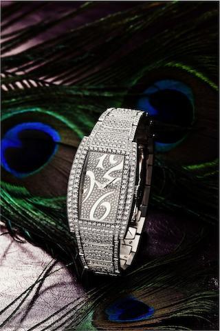 Piaget. A fine and rare 18ct white gold and diamond set lady's quartz bracelet watch Limelight Tonneau, Case No.953048, Recent