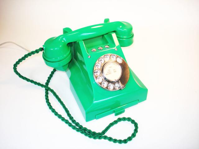 A near-mint 300-series green bakelite telephone, 1950, impressed mark 164-50,