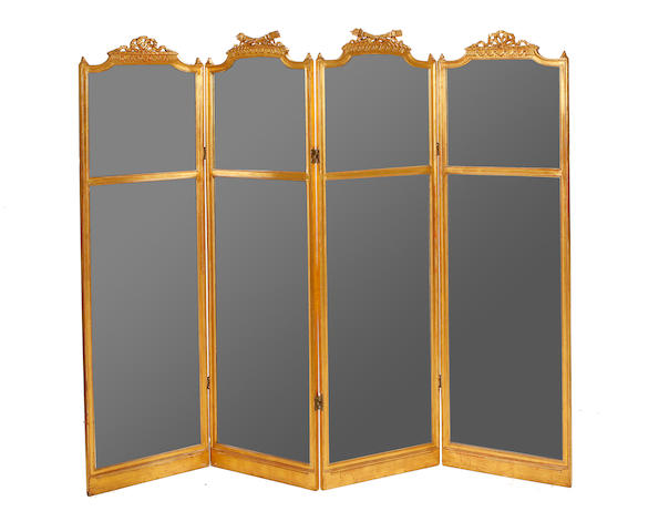 A French late 19th/early 20th century giltwood four panel screen in the Louis XVI style