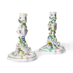 A pair of Meissen candlesticks