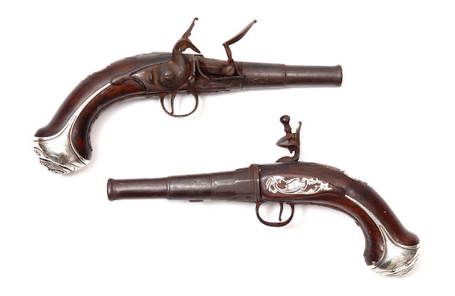 pair of 18th cent travelling pistols