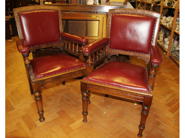 A set of twelve carved oak open armchairs Circa 1900