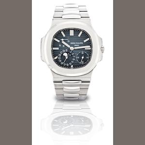 Patek Philippe. A fine stainless steel automatic bracelet watch with calendar, power reserve and moon phase Ref:5712/1A, Case No.4456621, Movement No.3178377, Sold in 2009