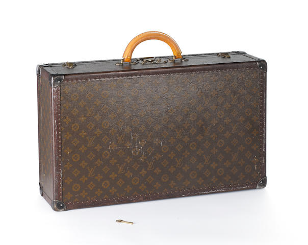 LOUIS VUITTON: An early 20th century leather mounted suitcase,