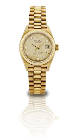 Rolex. A fine and rare 18ct gold and diamond set centre seconds calendar lady's automatic bracelet watchOyster Perpetual Datejust, Ref:69178, Case No.9511402, Circa 1986