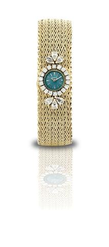 Piaget. A fine and rare 18ct gold and diamond set lady's manual wind bracelet watch Circa 1970