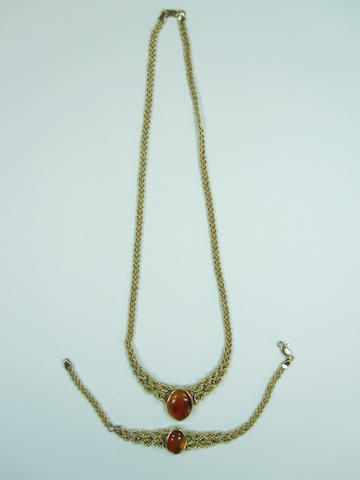 A 14ct gold necklace and bracelet set with amber