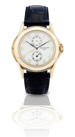 Patek Philippe. A fine 18ct gold dual time manual wind wristwatch  Ref:5134J, Case No.4183125, Movement No.3084761, Circa 2000s