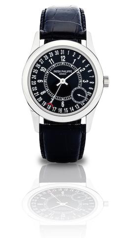 Patek Philippe. A fine 18ct white gold automatic calendar wristwatch Ref:6000G, Case No.4356736, Movement No.3510762, Circa 2000s