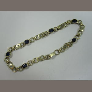 Yellow metal link bracelet set with white and blue stones