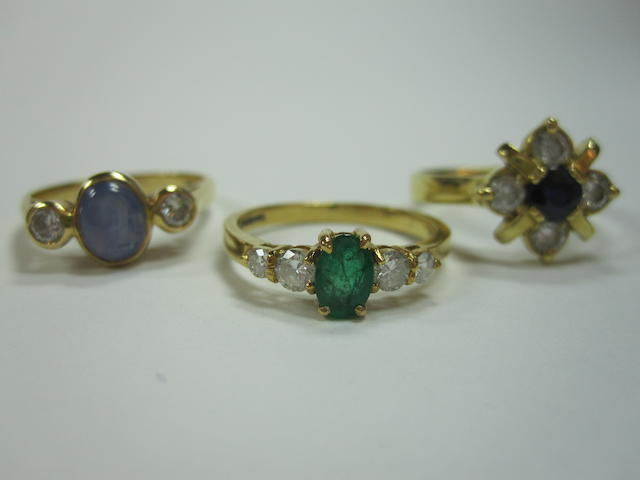 A sapphire and diamond ring, an emerald and diamond ring and a sapphire and diamond cluster ring (3)