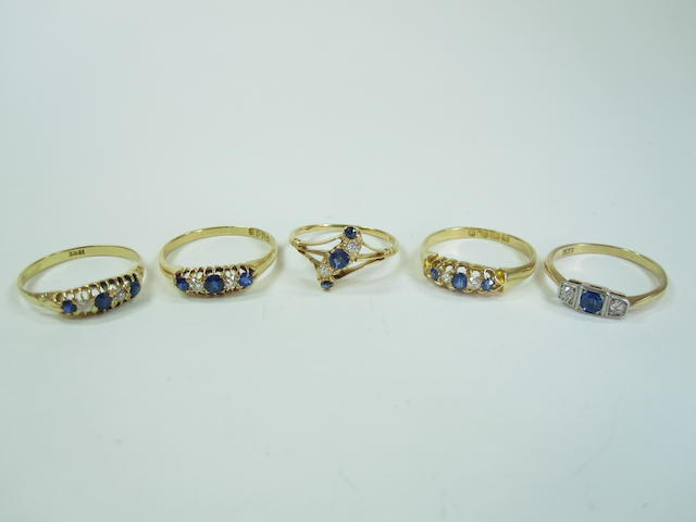 A collection of five sapphire and diamond rings