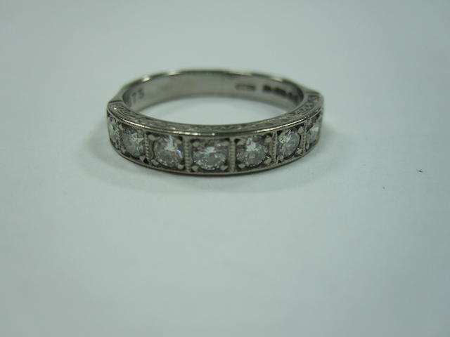 A diamond half eternity ring