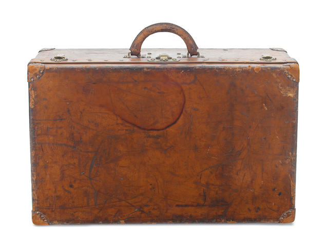 LOUIS VUITTON: A late 19th century tan leather suitcase, circa 1891,