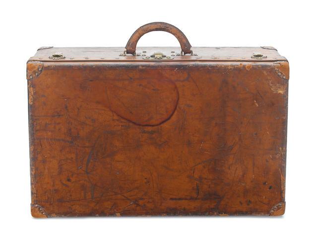 LOUIS VUITTON: A late 19th century tan leather suitcase, circa 1891,