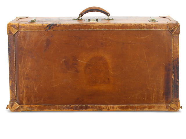 HERMÈS: A tanned leather suitcase,