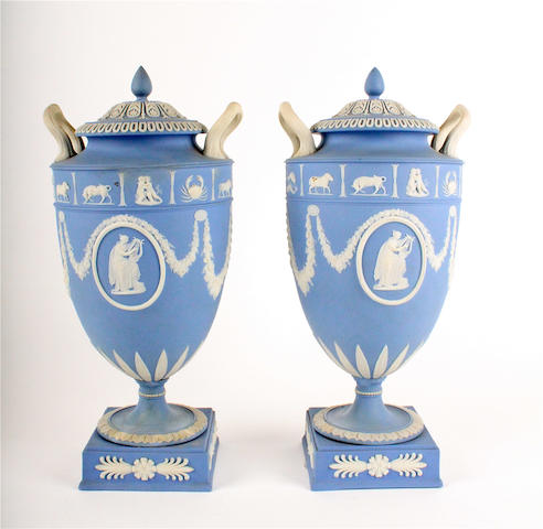 A pair of Wedgwood Jasperware twin handled urns and covers19th century