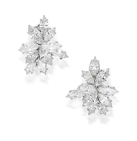 A pair of diamond ear clips