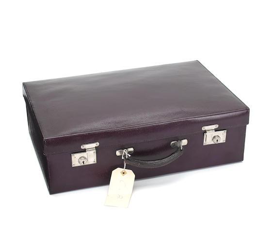 ASPREY: 20th century fitted  purple leather 22inch suitcase / vanity case,  retailed by Asprey, contents by varying makers, 19th century,